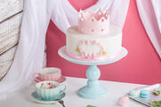 Canva - Cute pink cake with a crown on the table to the birthday for a Princess