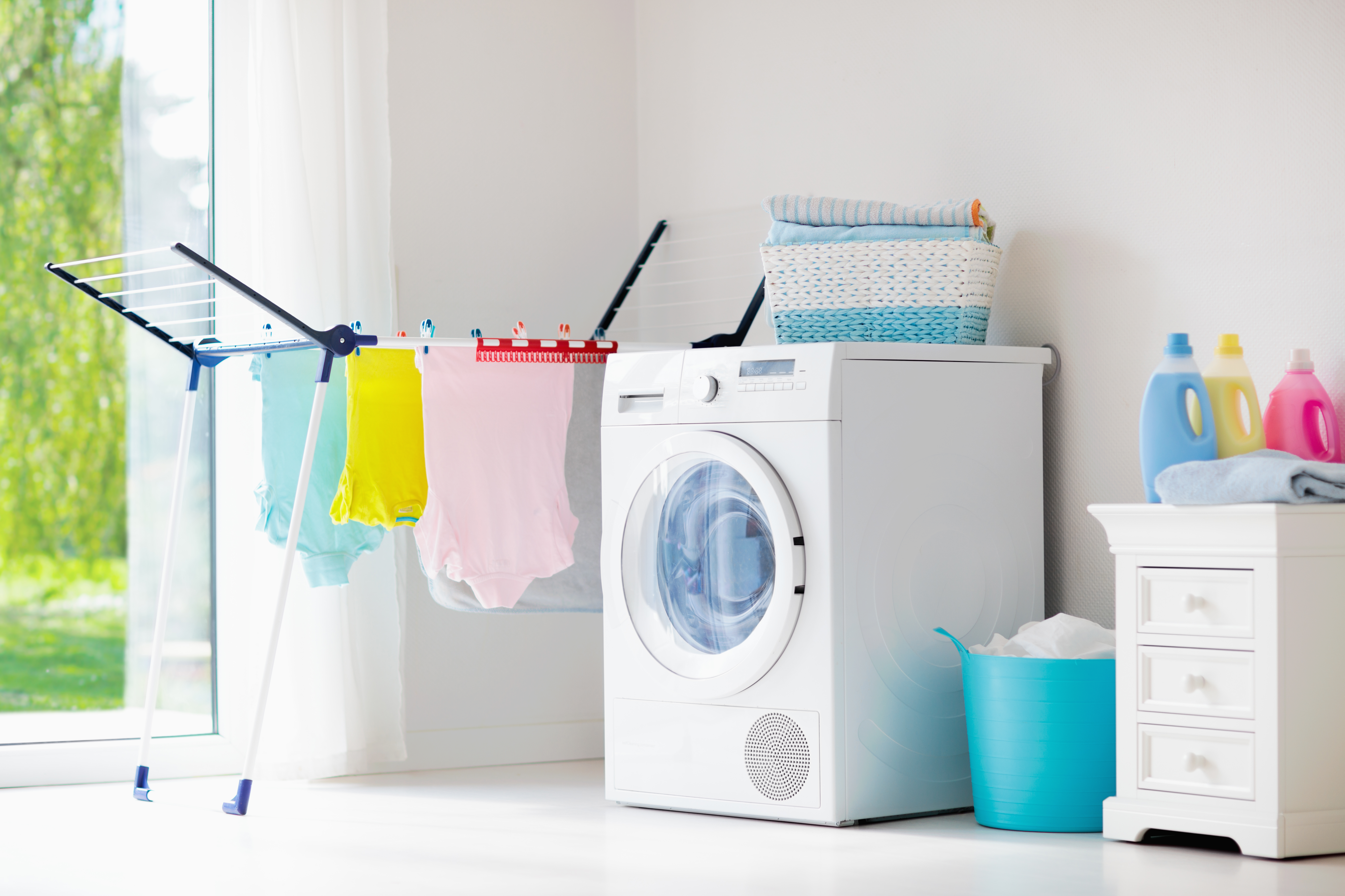 Canva - Laundry room with washing machine