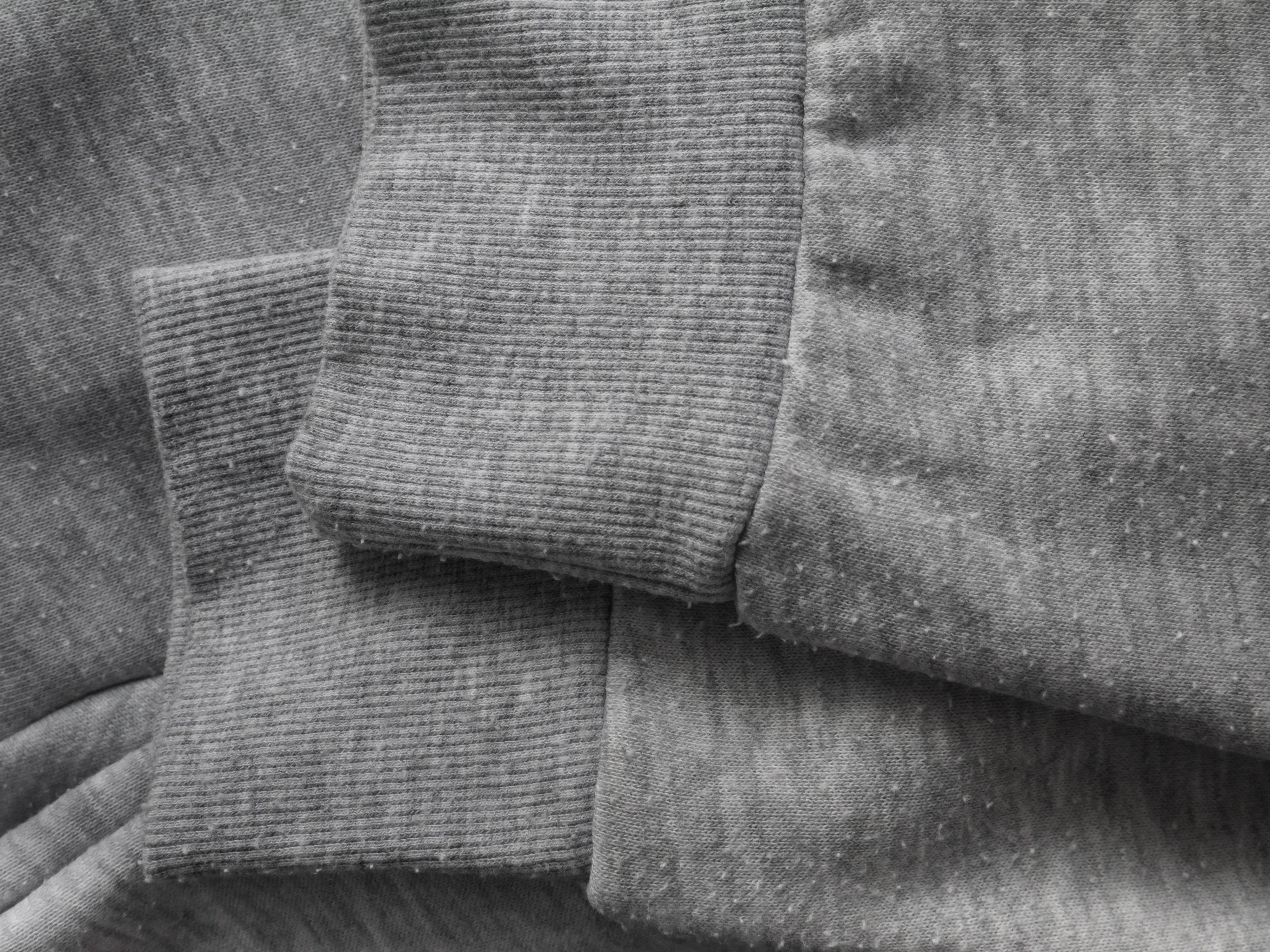 Canva - Pills on the heather gray sweatshirt cotton knit fabric