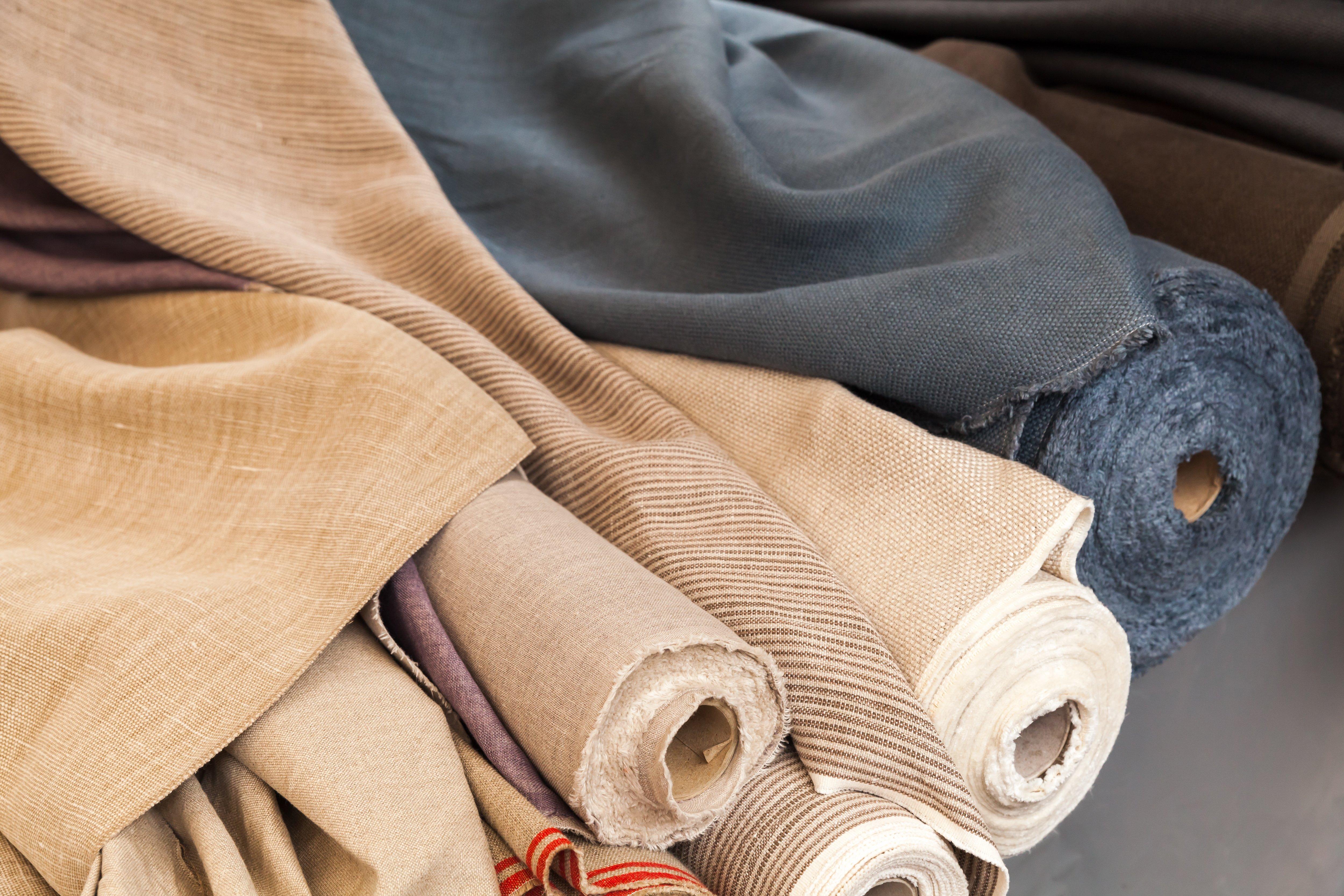 Canva - Rolls of natural linen cloth