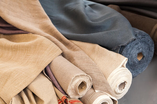 Canva - Rolls of natural linen cloth