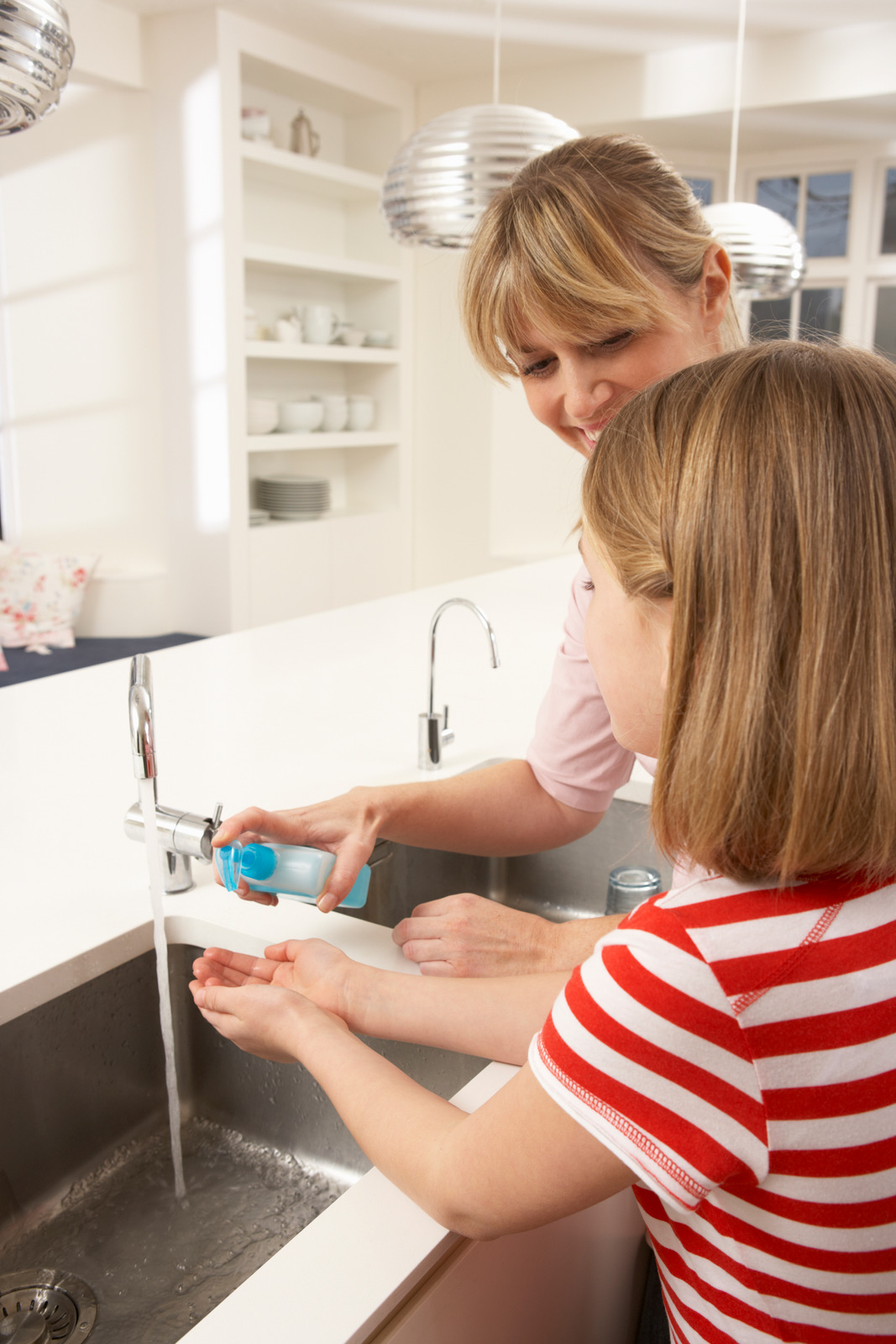 Canva - Mother and Daughter Washing Hands at Kitchen Sink